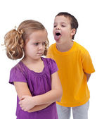 Upset little girl bullied by older boy — Stock Photo