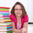 Young girl with lots of books — 图库照片
