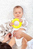 Changing diapers on a baby girl — Stock Photo