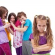 Stock Photo: Group of kids bullying their colleague