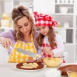 Making a cake - woman and little girl — Stock Photo