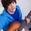 Happy teenager with guitar - Photo