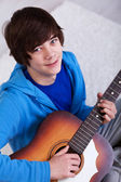 Happy teenager with guitar — Stock Photo