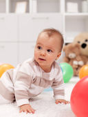 Baby girl with balloons — Stock Photo