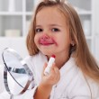 Little girl playing with makeup — Stock Photo