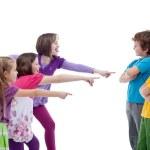 Girls mocking boys - school bullying concept — Stock Photo