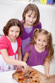 Young girls having pizza — Stock Photo