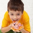 Boy eating pizza — Stock Photo #9246886