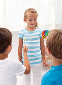 Boys courting a little girl — Stock Photo