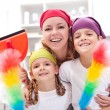 Cleaning taskforce - womwith kids tidy up — Stock Photo #9393454