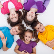 Five happy kids on the floor — Stock Photo
