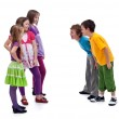 Group of boys and girls mocking each other — Stock Photo