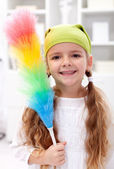 Little girl with dusting brush — Stock Photo