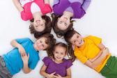 Five happy kids on the floor — Stock Photo