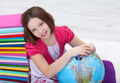Young girl with study materials — Stock Photo