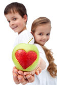Happy healthy kids holding apple — Stock Photo