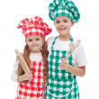Happy kid chefs with wooden cooking utensils — Stock Photo
