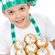 Little boy chef with muffins — Stock Photo