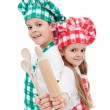 Happy chef kids with wooden cooking utensils — Stock Photo