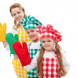 Happy chefs waving with oven gloves — Stock Photo