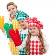 Happy chefs waving with oven gloves — Stock Photo #9724971