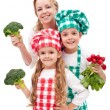 Happy family preparing healthy vegetables meal — Stock Photo #9724994