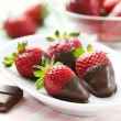 Chocolate dipped strawberries - Stock Photo