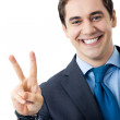 Businessman showing two fingers or victory sign — Stock Photo #10117033