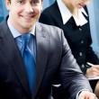 Portrait of smiling businessman at office — Stockfoto