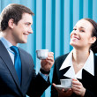 Businesspeople with coffee at office — Stock Photo