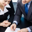 Businesspeople with documents at office — Stockfoto