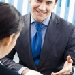 Happy businesspeople, or business man and client — Stockfoto