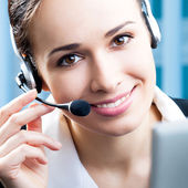 Happy smiling support phone operator at office — Stok fotoğraf