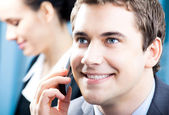 Businessman with cellphone at office — Stock Photo