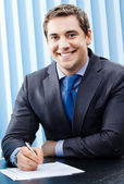 Portrait of smiling businessman at office — Stock Photo