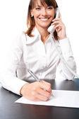 Zakenvrouw met telefoon schrijven, geïsoleerd — Stockfoto