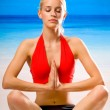 Woman doing yoga exercises or meditating — Stock Photo