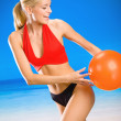 Young woman playing with ball on beach — Stock Photo #10472833