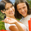 Stock Photo: Young couple with shopping bags, outdoor
