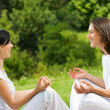 Young couple meditating together, outdoors - Stok fotoğraf