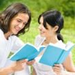 Young couple or students, reading a book — Stock Photo #10674108