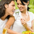 Young happy couple at picnic, outdoors — Stock Photo #10674145