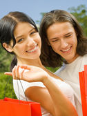 Young couple with shopping bags, outdoor — Stock Photo