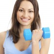 Young woman exercising with dumbbell, isolated — Stock Photo #10704292