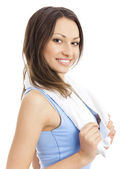 Woman in fitness wear with towel, on white — Stock Photo