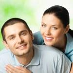 Portrait of happy couple, outdoors — Stock Photo #8417878