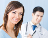 Smiling patient and doctor at office — Stock Photo