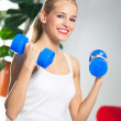 Woman exercising with dumbbells, at home — Stock Photo #8664952