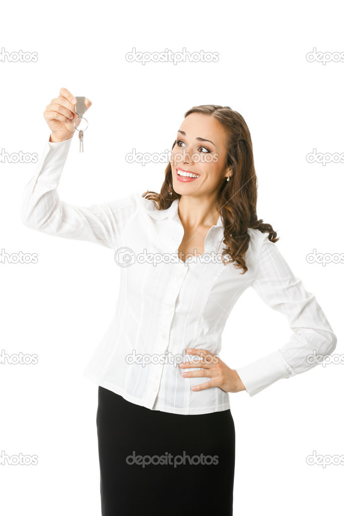 Young happy smiling business woman or real estate agent showing keys from new house, isolated on white background — Stock Photo #8759794