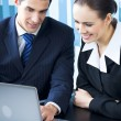 Stockfoto: Two businesspeople working with laptop at office